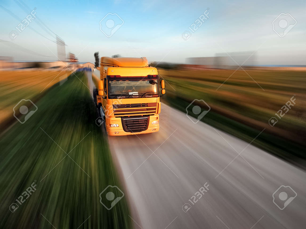 Logistics concept. Truck on country road, motion blur effect - 152330838