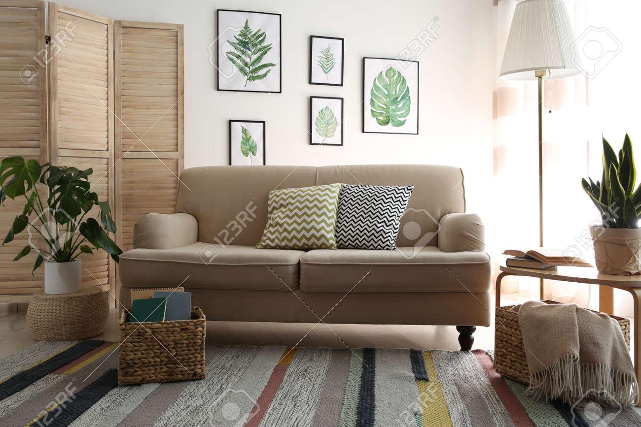 Modern living room interior with stylish comfortable sofa - 155528926