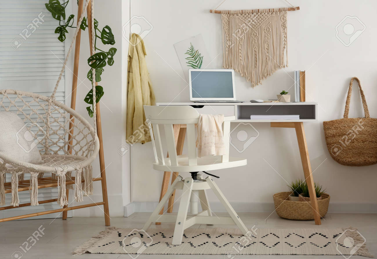 Stylish room interior with workplace and hanging chair - 155890429