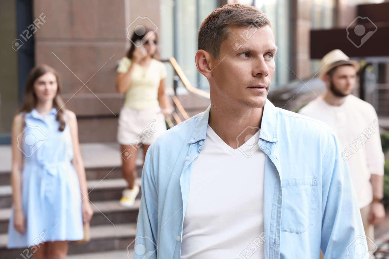 Handsome man walking on modern city street - 156592521