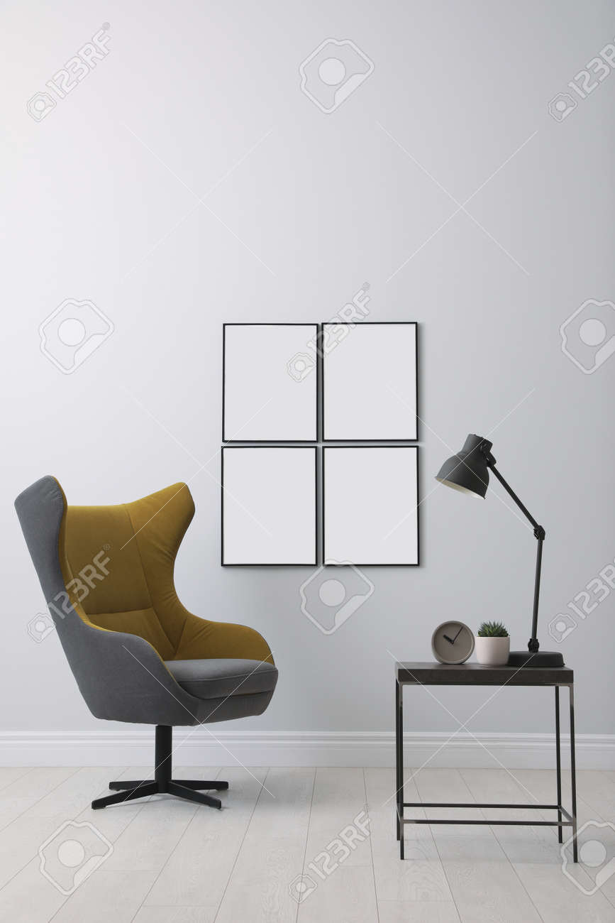 Stylish room interior with empty posters on wall. Mockup for design - 155077029