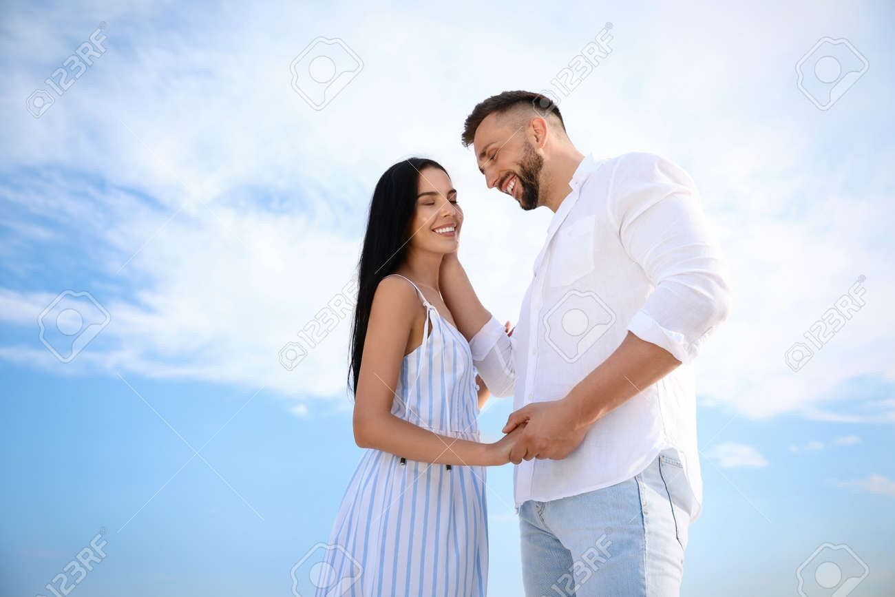 Happy young couple on sunny day. Beach holiday - 155447717