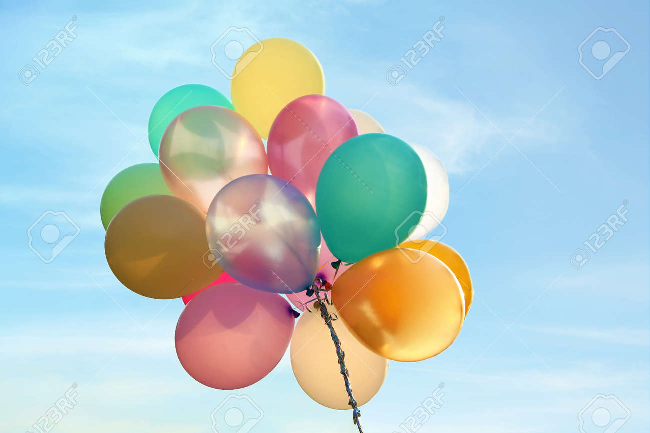 Bunch of bright balloons in blue sky - 155486570