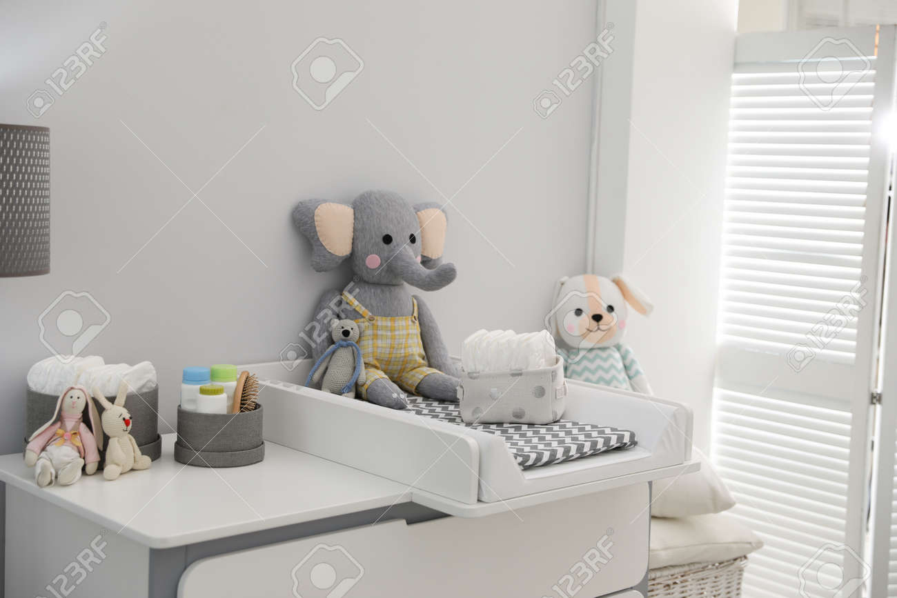 Changing tray and pad on chest of drawers in baby room. Interior design - 155667565
