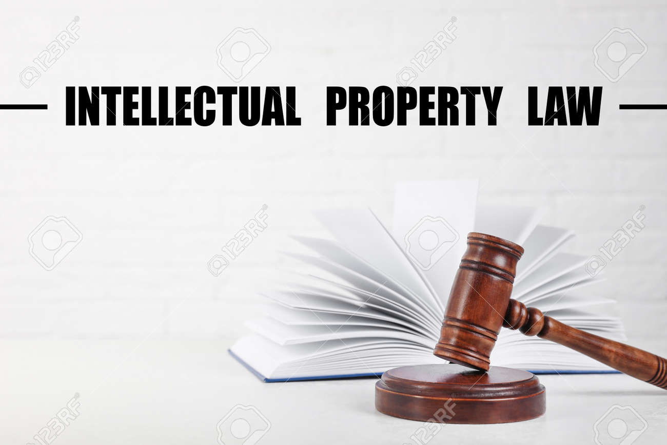 Text Intellectual Property Law over judge's gavel and book on table - 156034021
