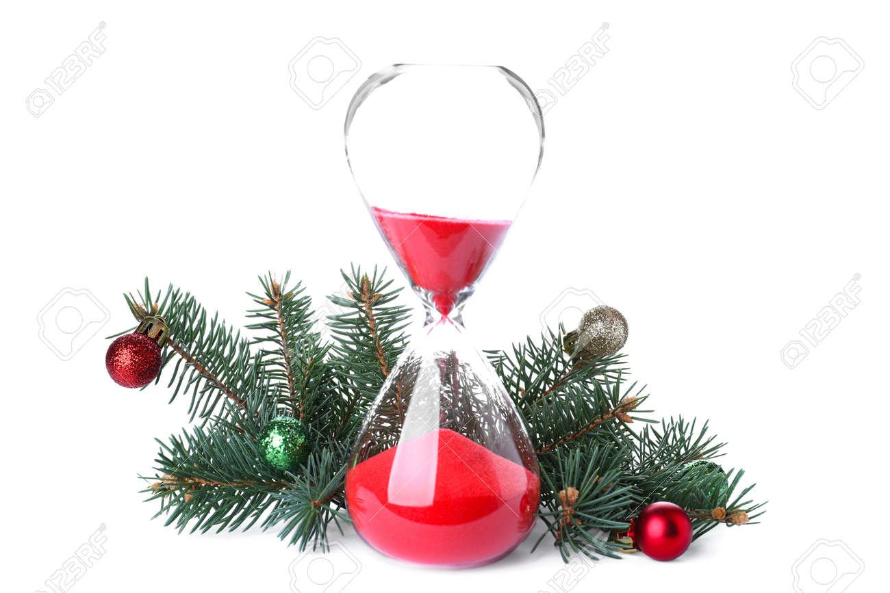 Hourglass, fir tree twigs and decor on white background. Christmas countdown - 157726500