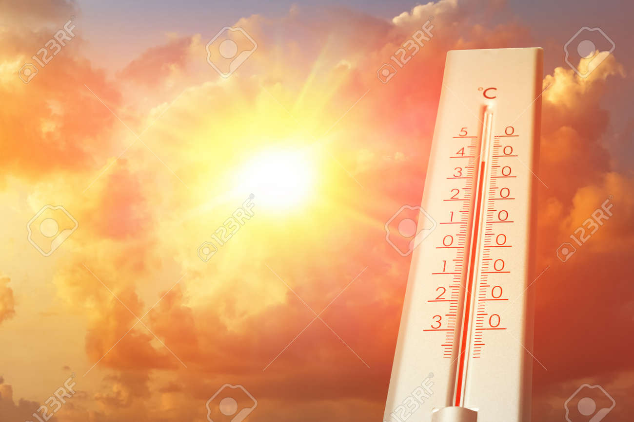 Weather thermometer showing high temperature and sunny sky with clouds on background - 157921230