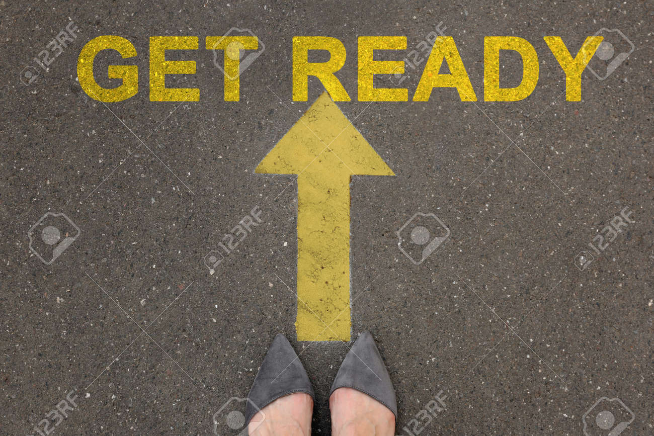 Text Get Ready and arrow on asphalt in front of woman, top view - 158934254