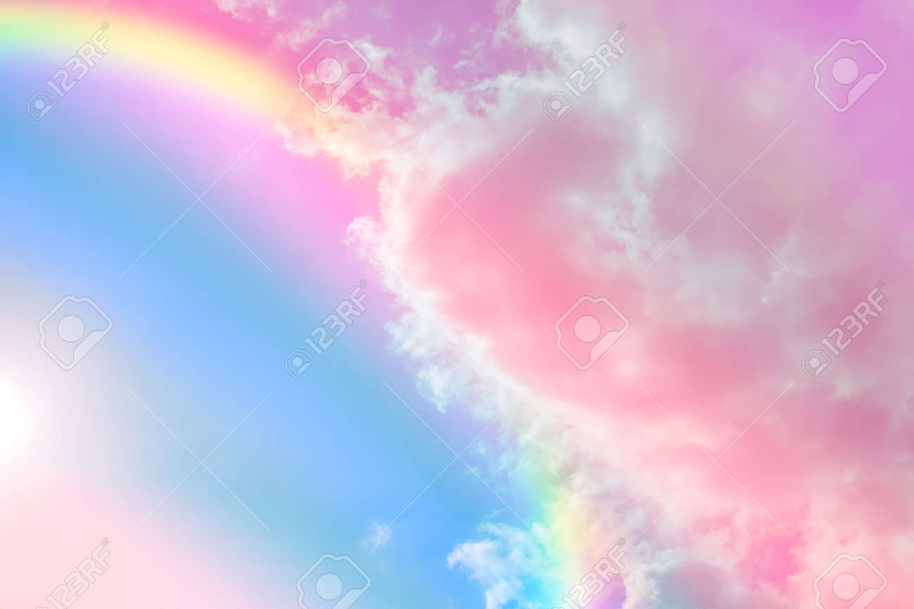 Amazing sky with rainbow and fluffy clouds, toned in unicorn colors - 159582044