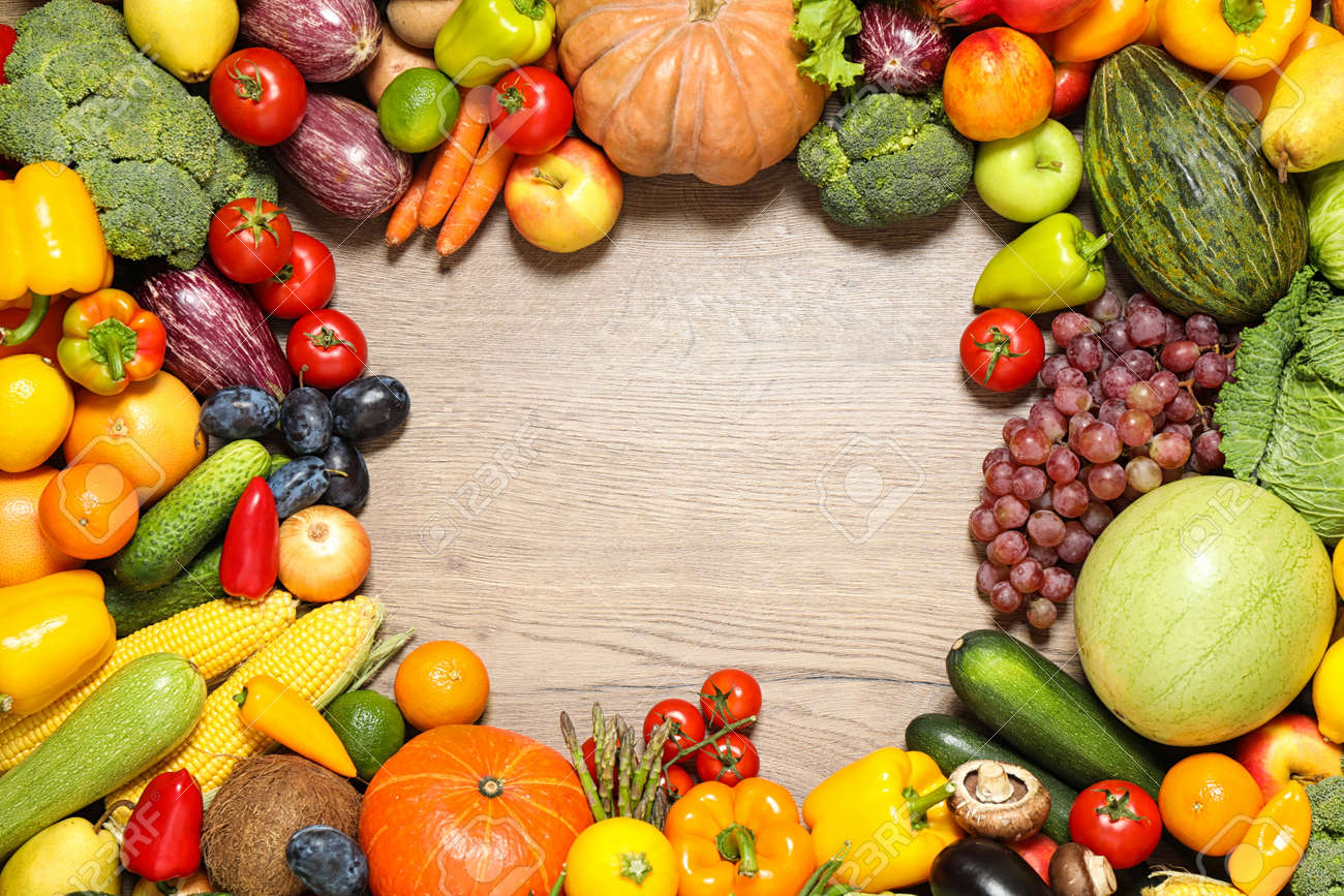 Frame of assorted fresh organic fruits and vegetables on wooden table, flat lay. Space for text - 159904675