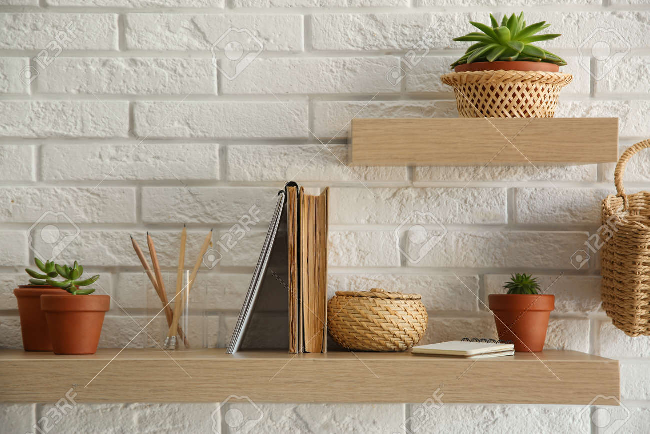 Shelves With Decorative Elements On White Brick Wall Interior Stock Photo Picture And Royalty Free Image Image 161077258