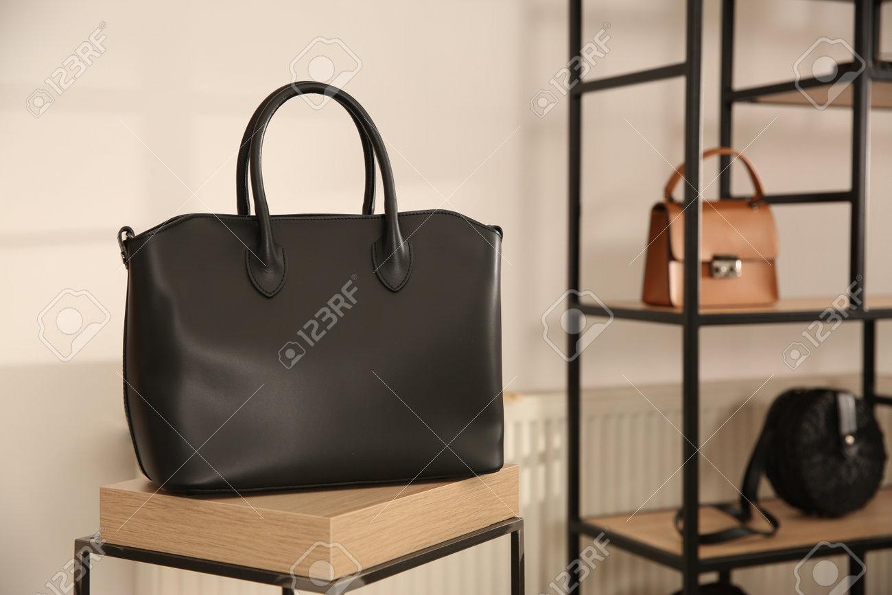 Elegant black bag on table in luxury boutique - 161598218