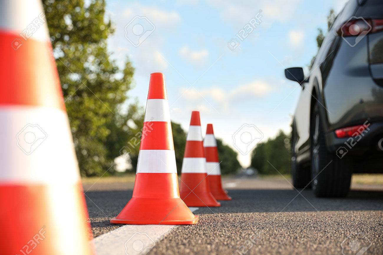 Traffic cones near car outdoors. Driving school exam - 162000540