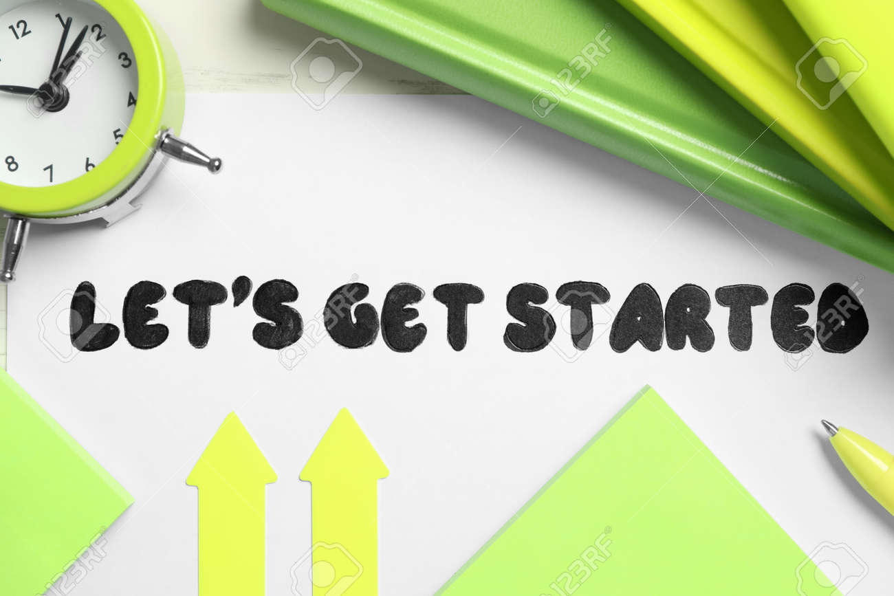 Sheet of paper with phrase Let's Get Started and stationery on white table, flat lay - 164311962
