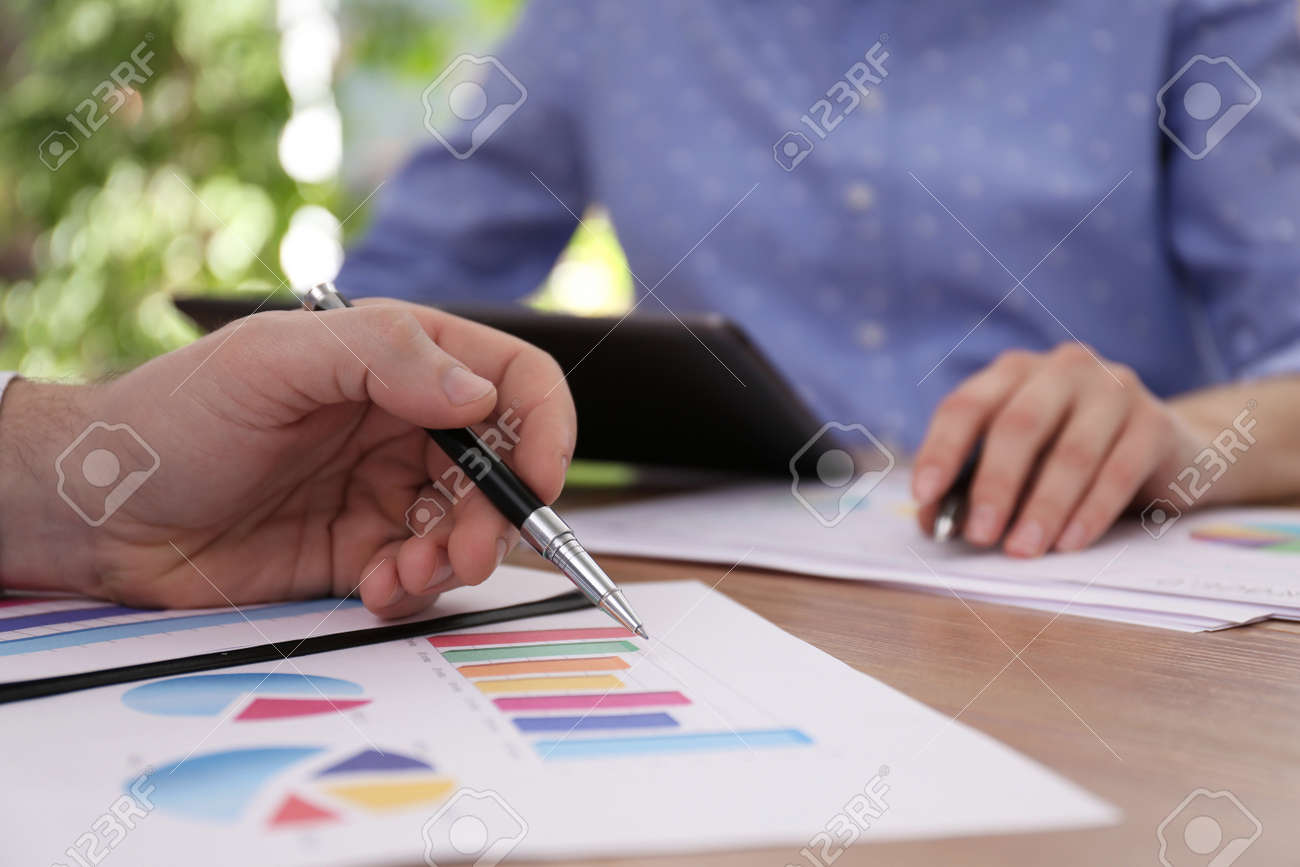 Business people working with charts and graphs at table in office, closeup. Investment analysis - 167082206
