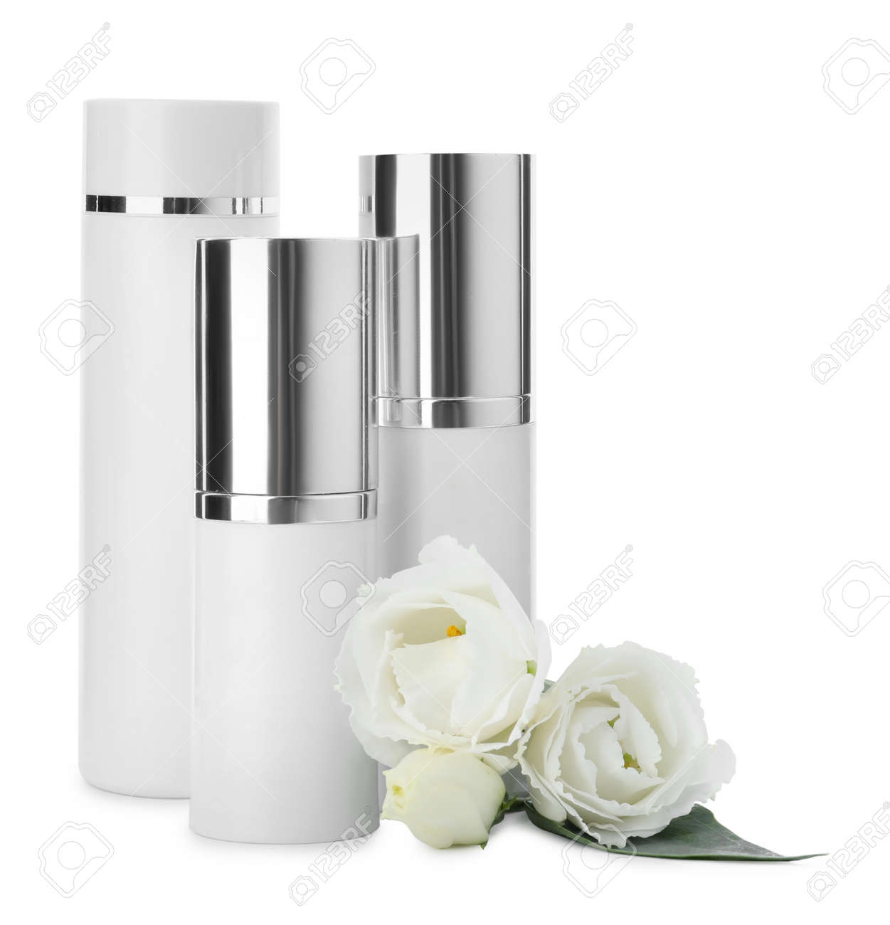 Different cosmetic products and fresh flowers on white background - 165360634