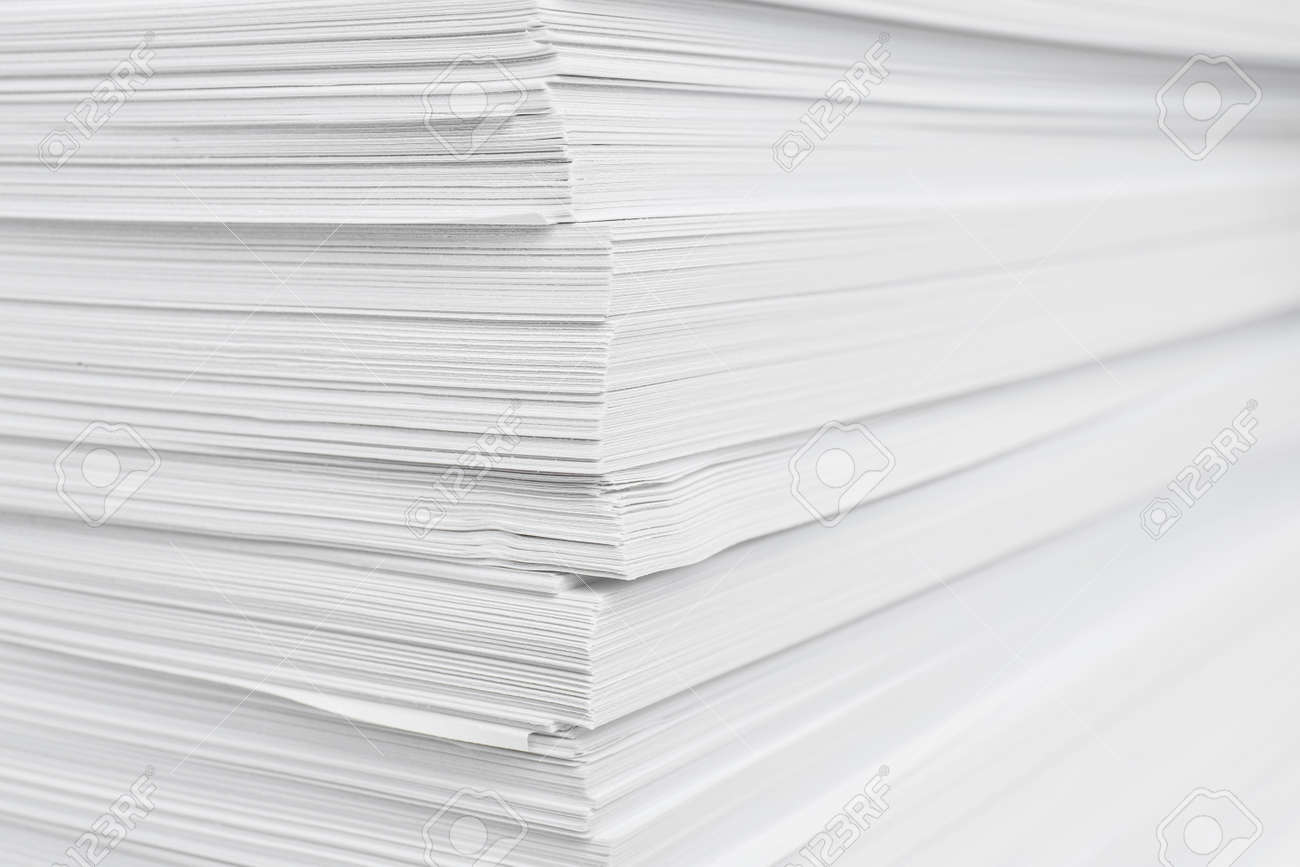 Stack of white paper sheets, closeup view - 165576039