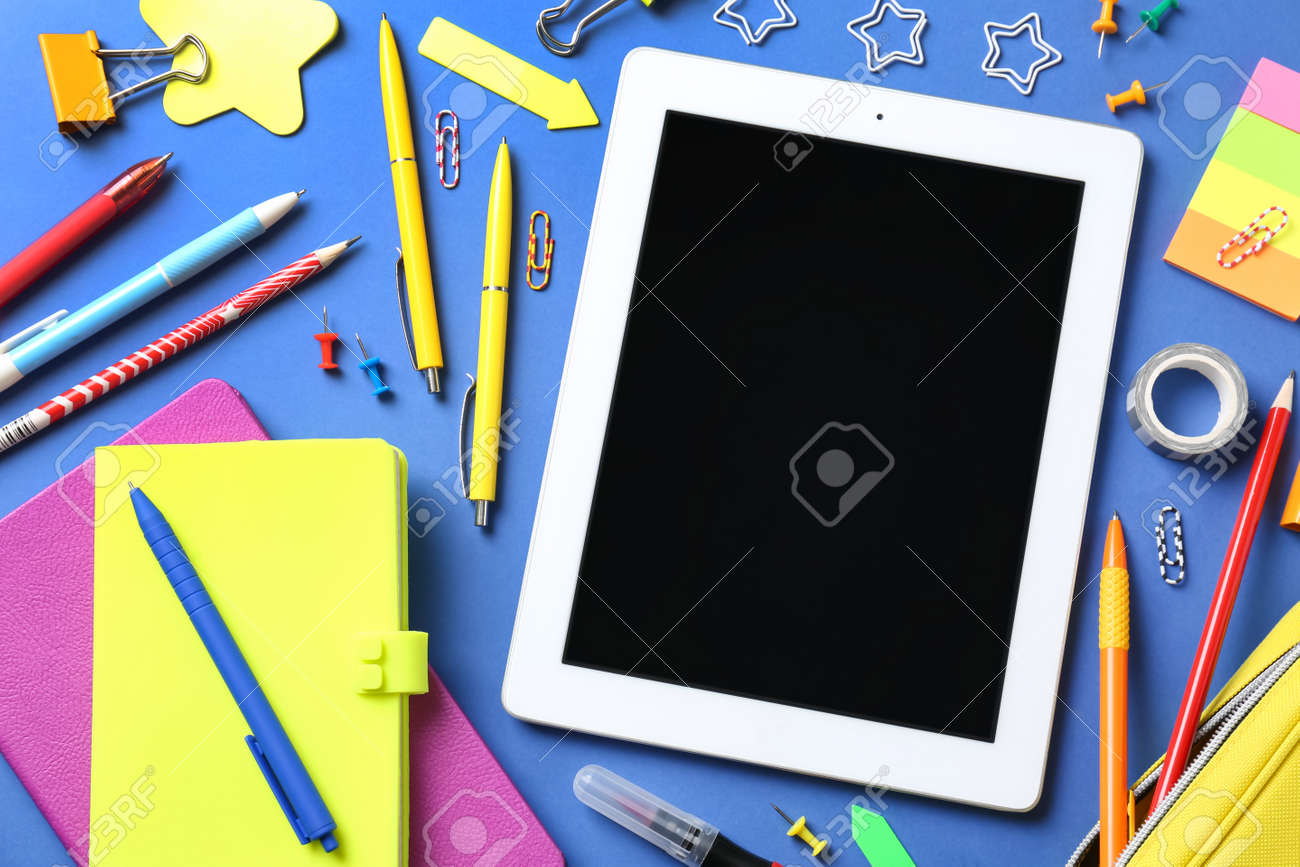 Flat lay composition with tablet on blue background - 165589596