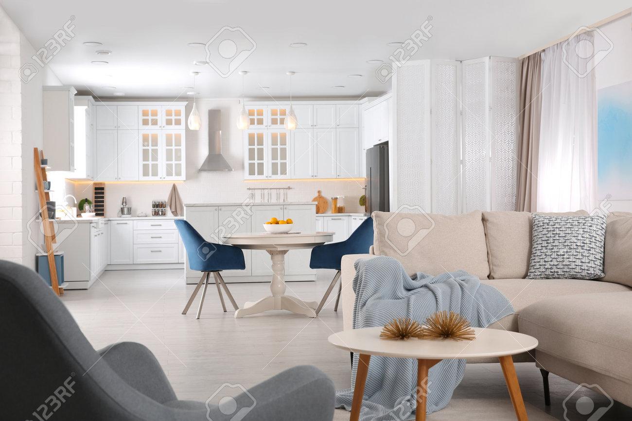 Stylish studio apartment interior with comfortable beige sofa - 166375968