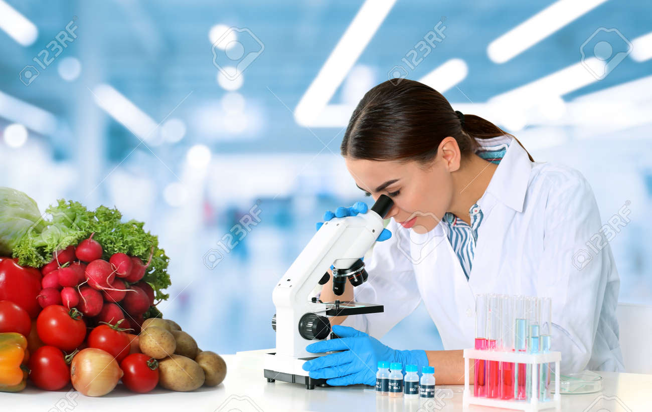Quality control specialist inspecting food in laboratory - 166686058