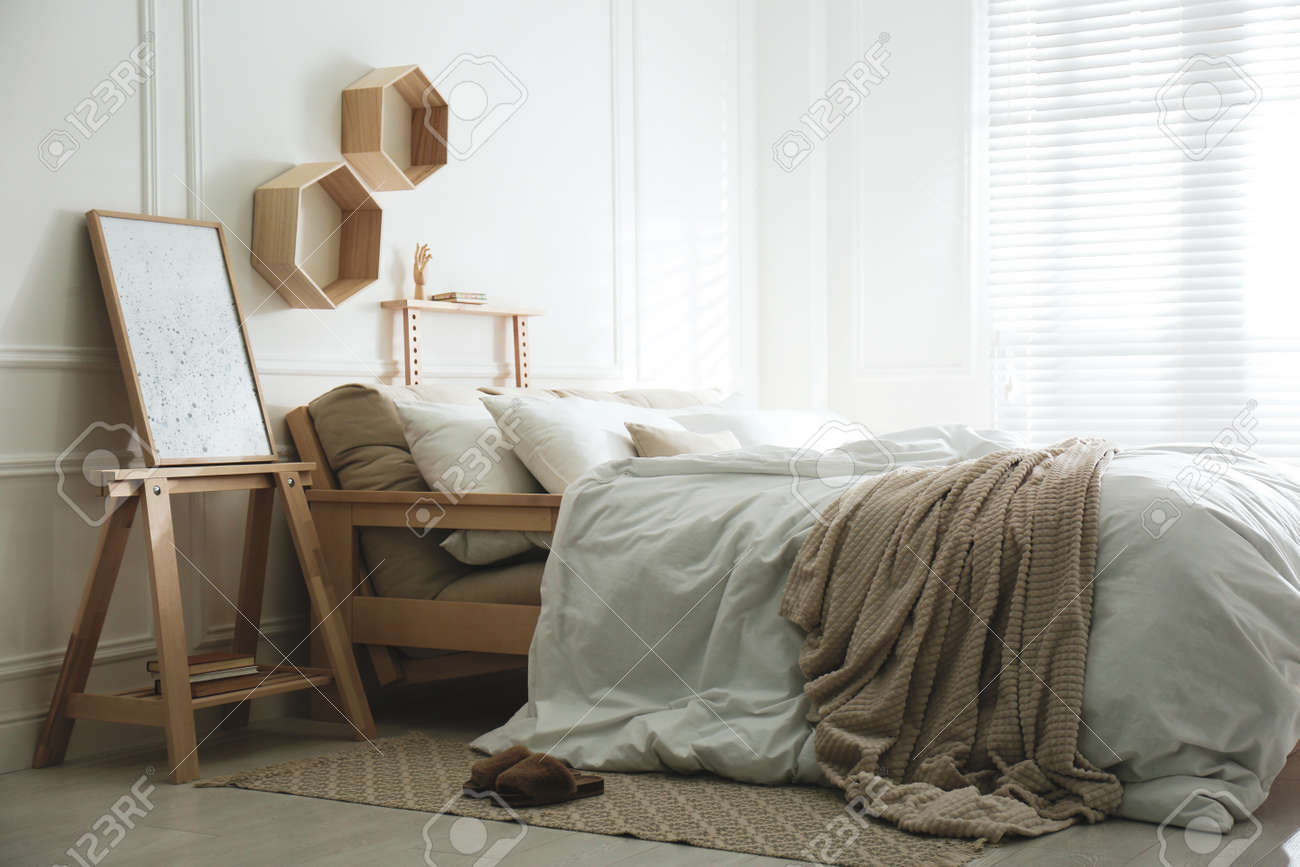 Stylish room interior with big comfortable bed - 166567724