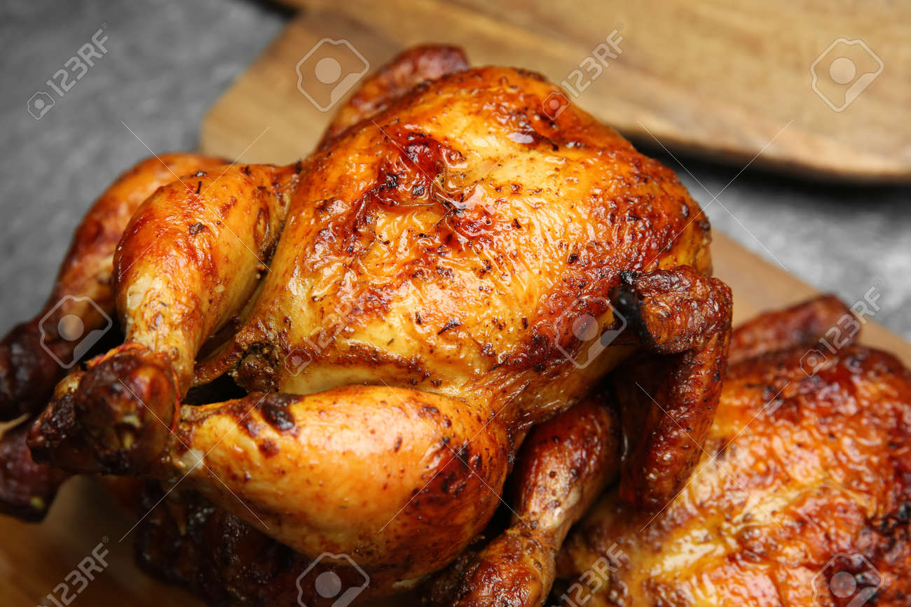 Delicious grilled whole chickens on gray table, closeup - 166873128