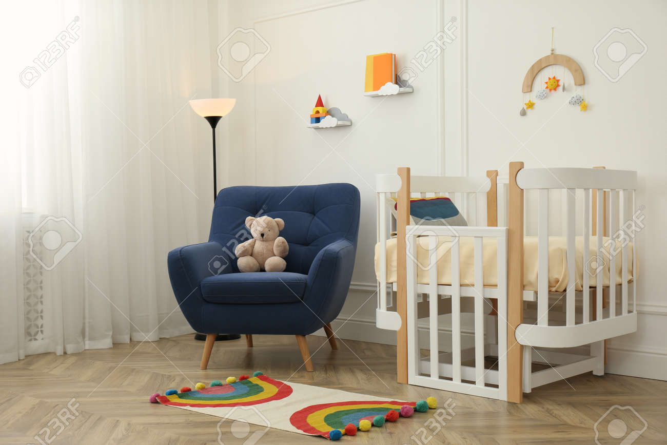 Cute baby room interior with stylish furniture and toys - 168096206