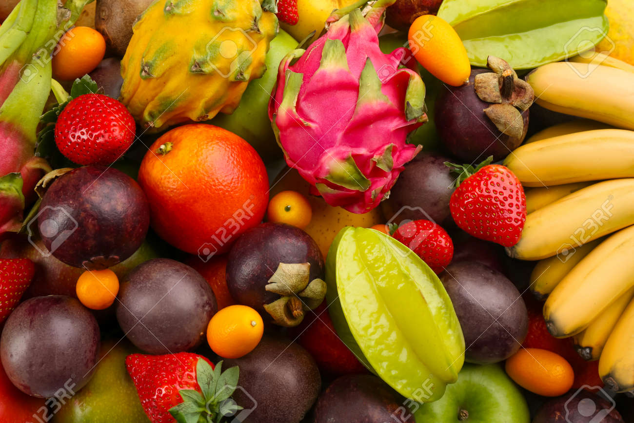 Assortment of fresh exotic fruits as background, top view - 169273673