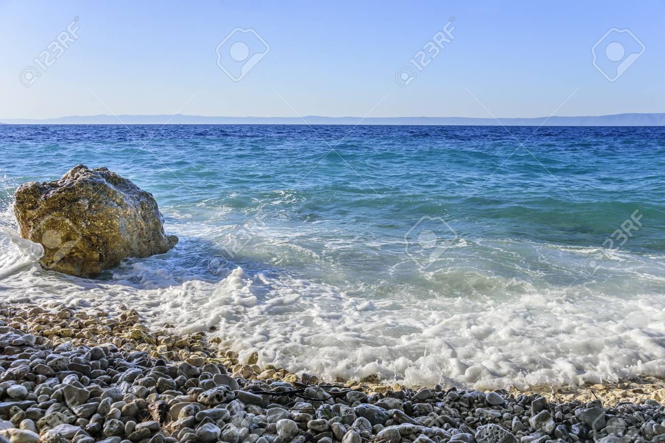 Sea beach  Sea waves crashing against the rocks on the coast