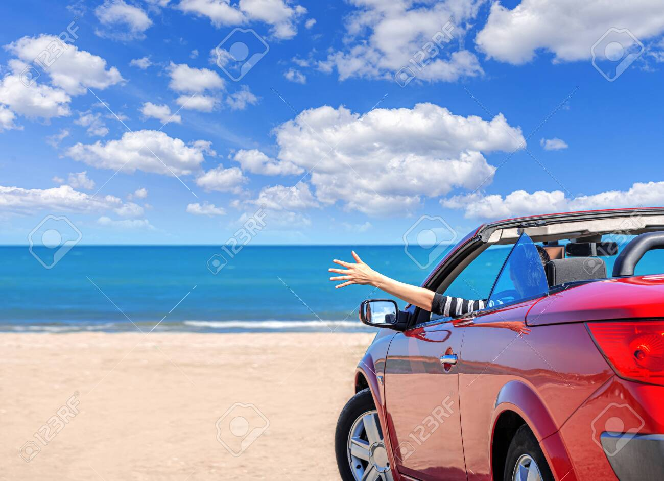 Red car on the beach. Vacation and freedom concept. - 151295421