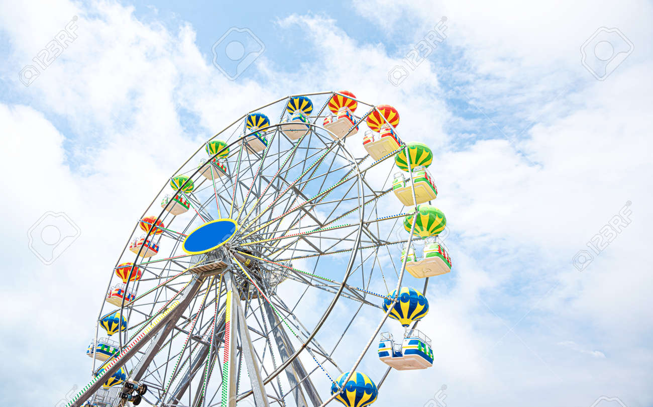 Ferris wheel against the sky. - 151555460