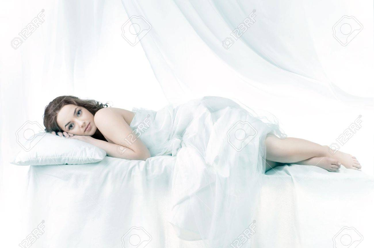 Beautiful woman sleeping over a white background Stock Photo - 9503681