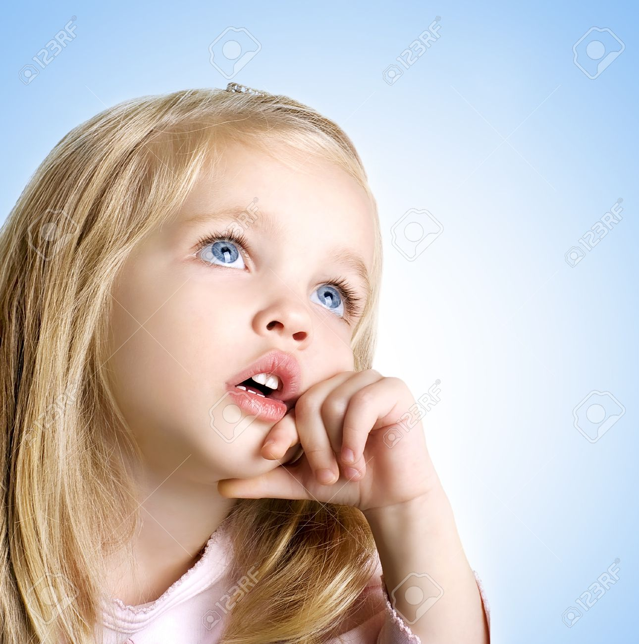 closeup image of a dreaming beautiful little girl with blue eyes Stock  Photo - 12666505