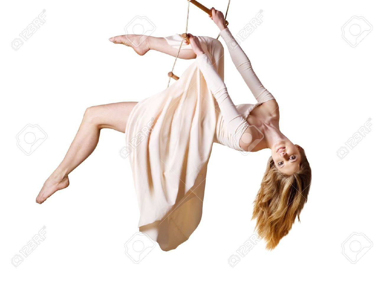 Young woman gymnast  on rope-ladder on white background Stock Photo - 17664039