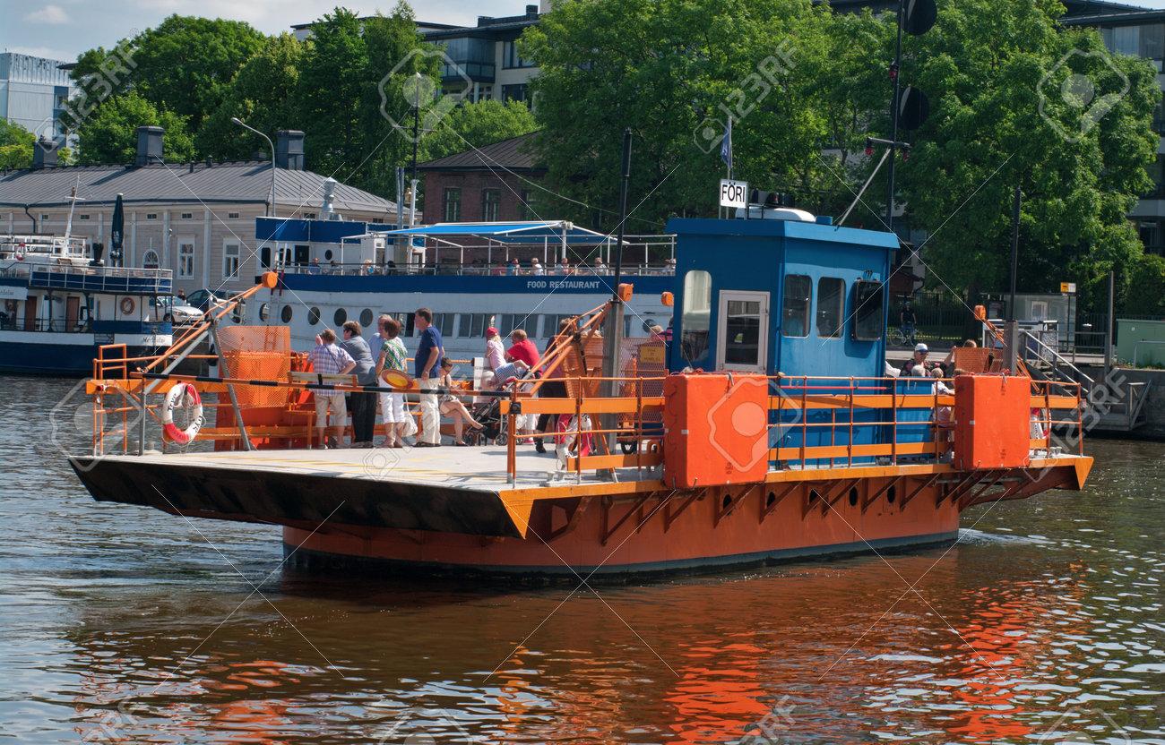 TURKU, FINLAND - JUNE 30: Passenger ferry on the Aura river  in Turku, Finland on June 30, 2013. Turku is popular tourist destination.  Stock Photo - 24047766