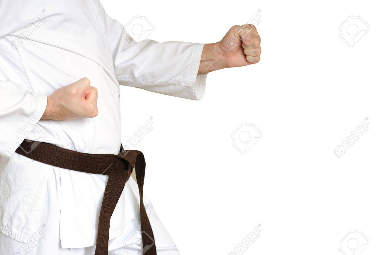 Man in a kimono and belt for martial arts on the white background - 17167530