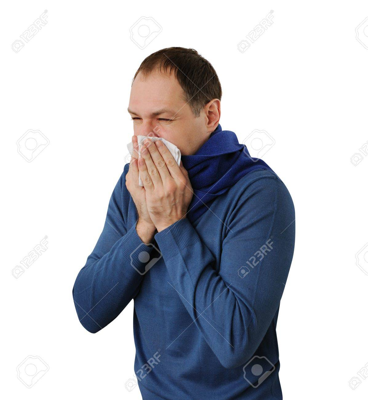 Man blowing his nose isolated on white background - 17456952