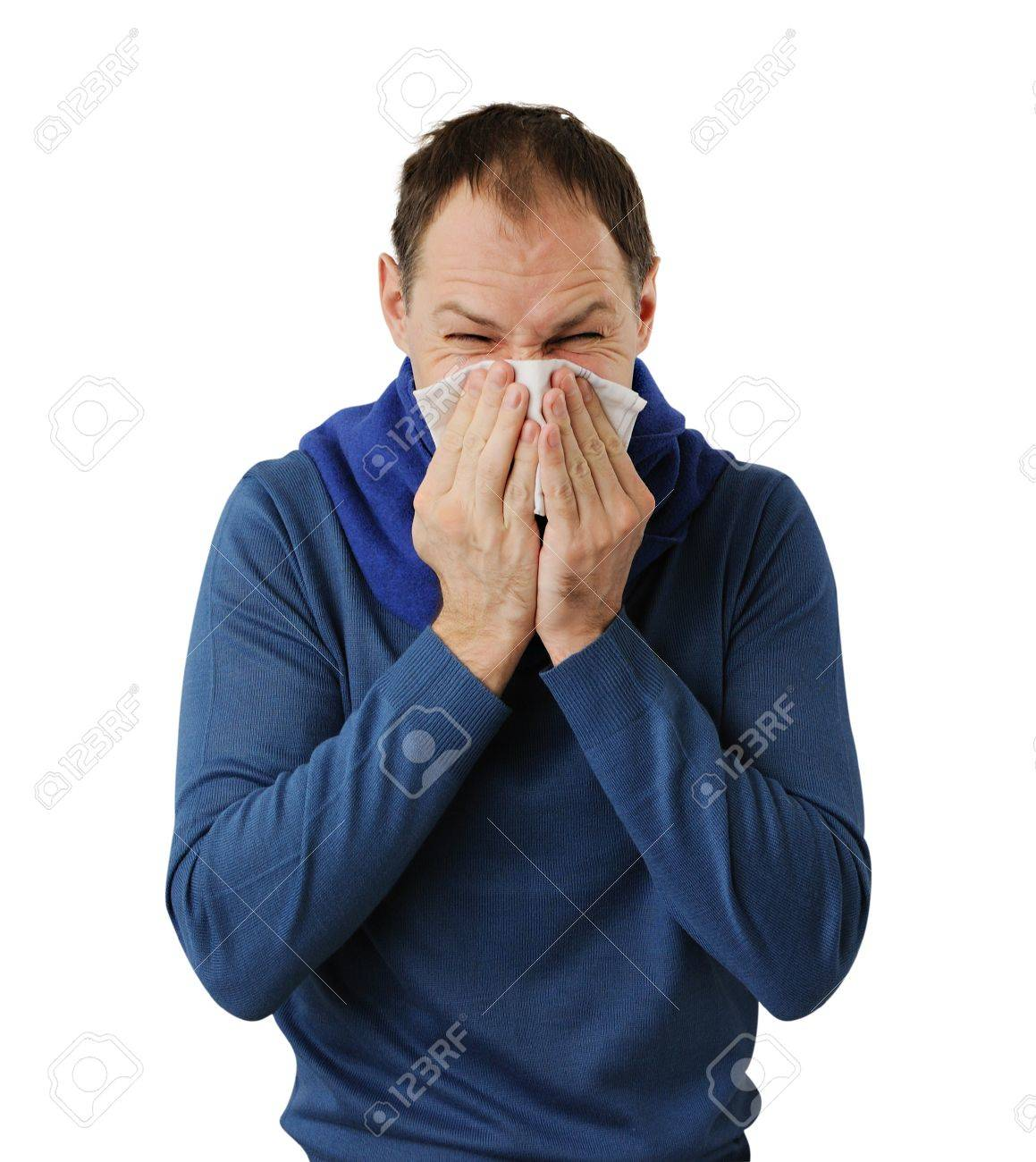 Man blowing his nose isolated on white background - 17456955