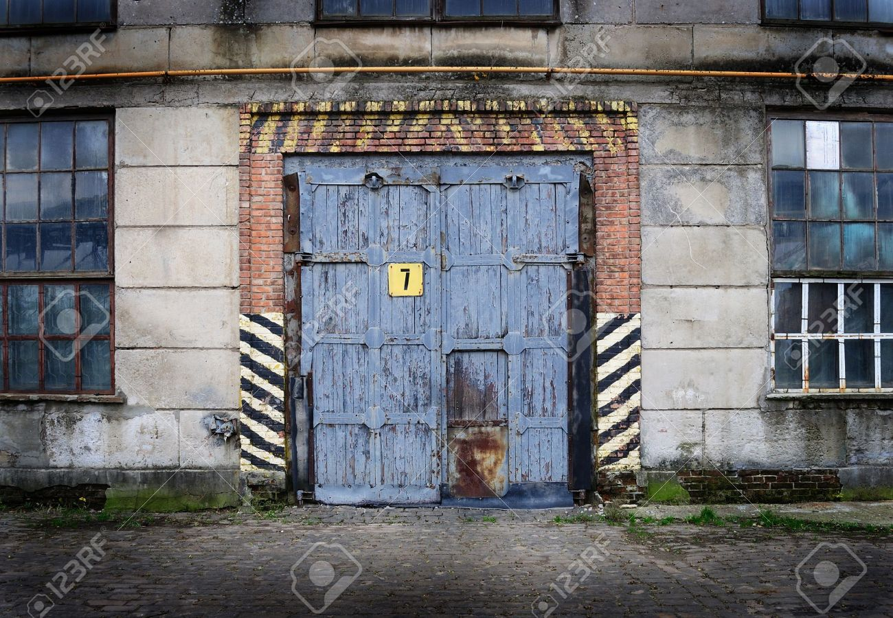 Vintage Old Factory With Closed Door And Windows Stock Photo   17933901