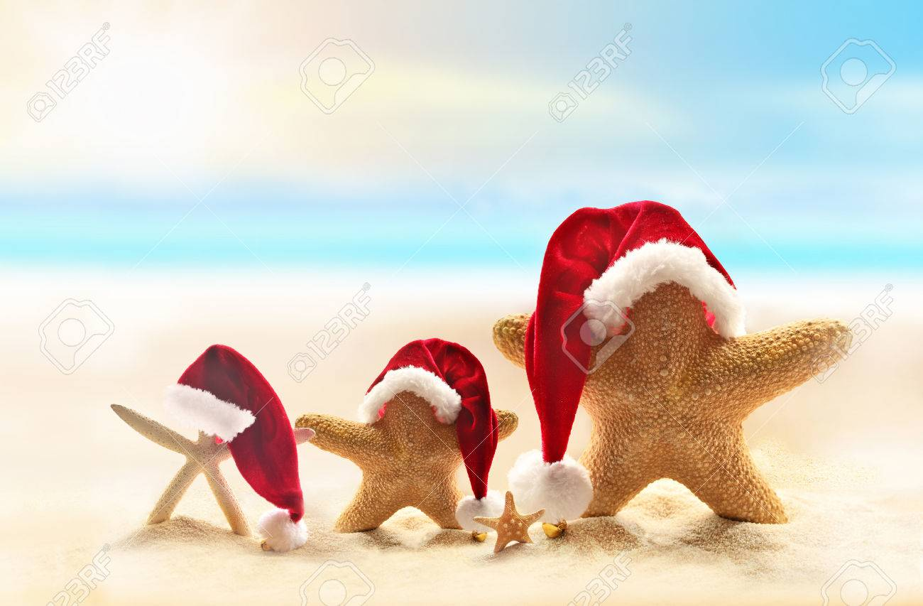 464209f4bf9c6 Starfish on summer beach and Santa hat. Merry Christmas. Stock Photo -  47665398
