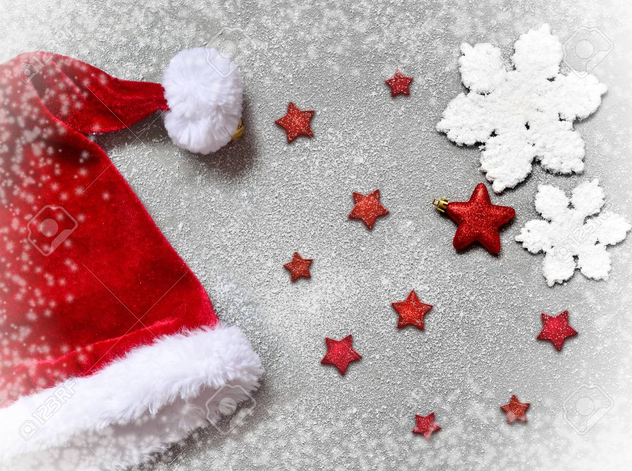 67387052 white christmas snowflakes decoration santa hat and red stars on gray background christmas wallpaper