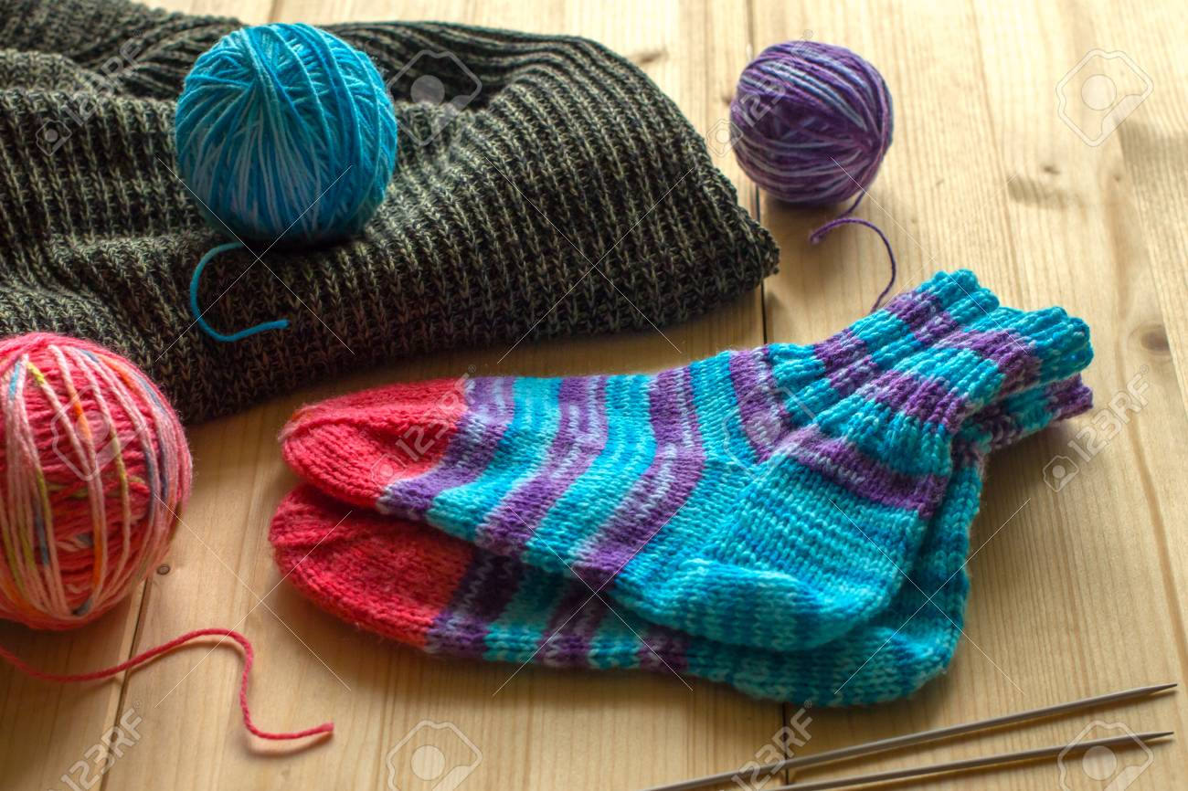 Handmade Knitted Baby Socks, Three Different Colored Skeins Of ...
