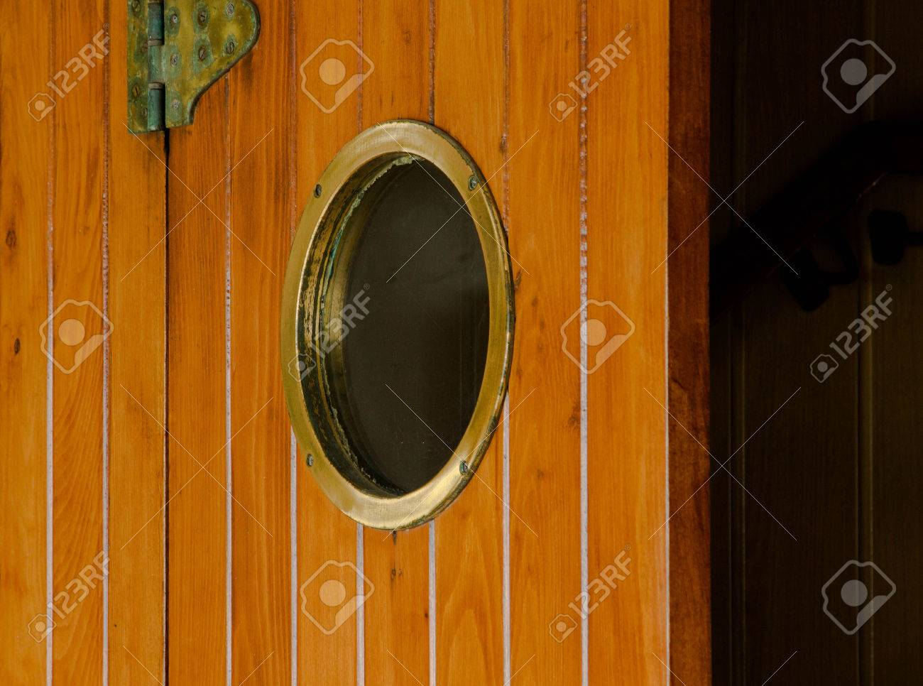 The Old Brown Wooden Ship Door With Round Window