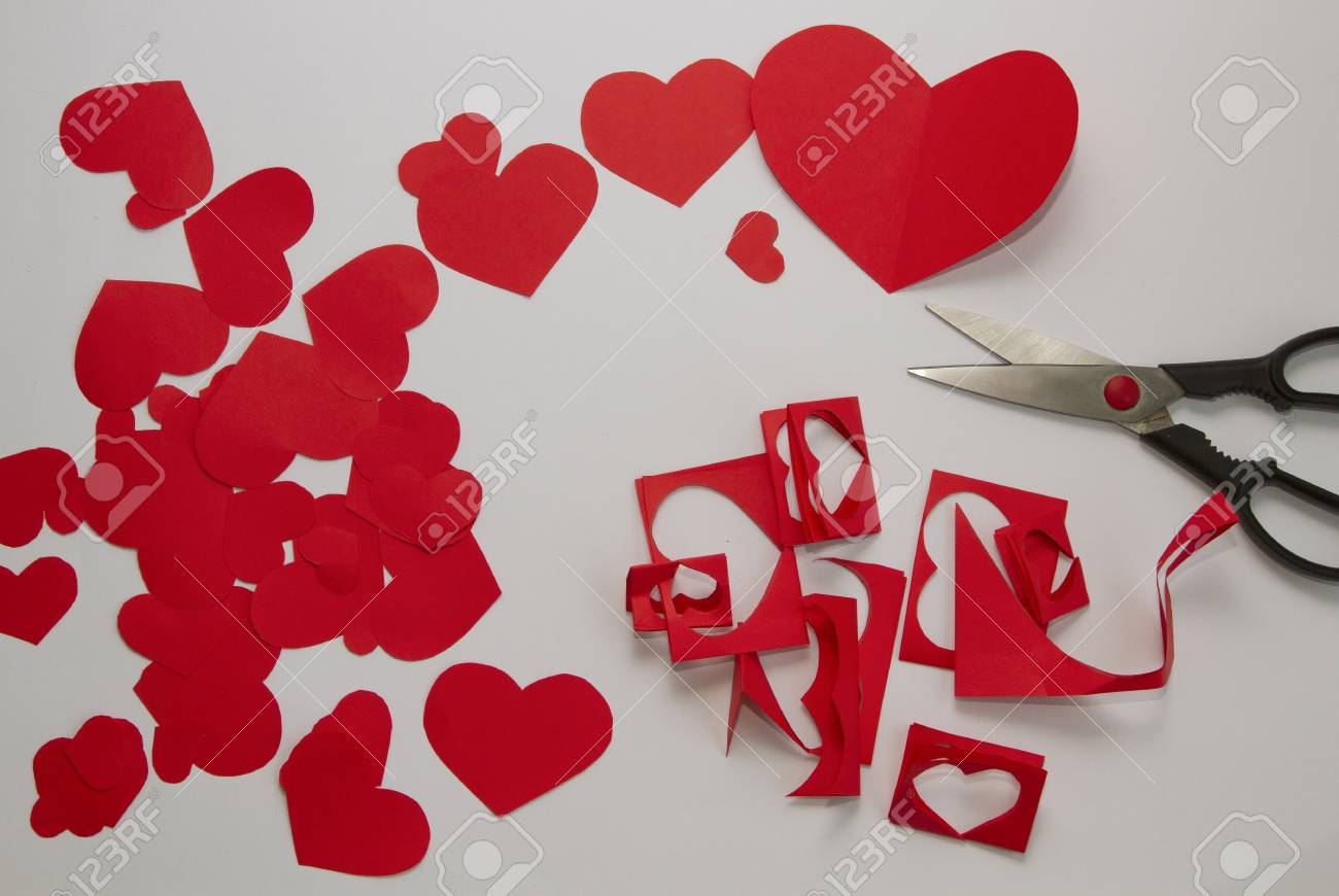Preparation of greeting cards for valentine s day from red paper preparation of greeting cards for valentine s day from red paper hearts and scissors stock m4hsunfo