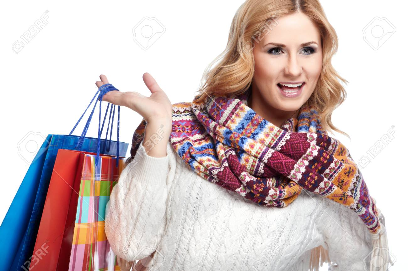 Winter and christmas shopping. Woman holding shopping bags Stock Photo - 24039229