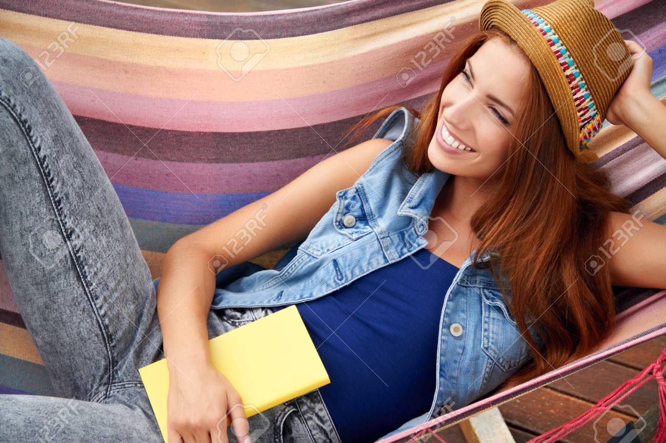 beautiful young woman resting in a hammock Stock Photo - 30529557
