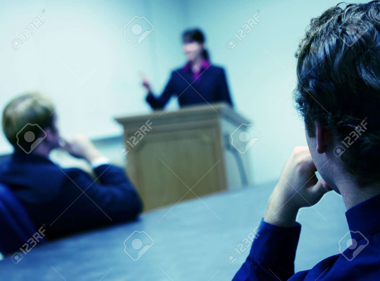 Business People in a meeting with a Business Woman leading Stock Photo - 2690569