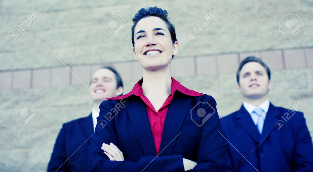 Three businesspeople in suits standing together in formation looking in same direction Stock Photo - 3093742