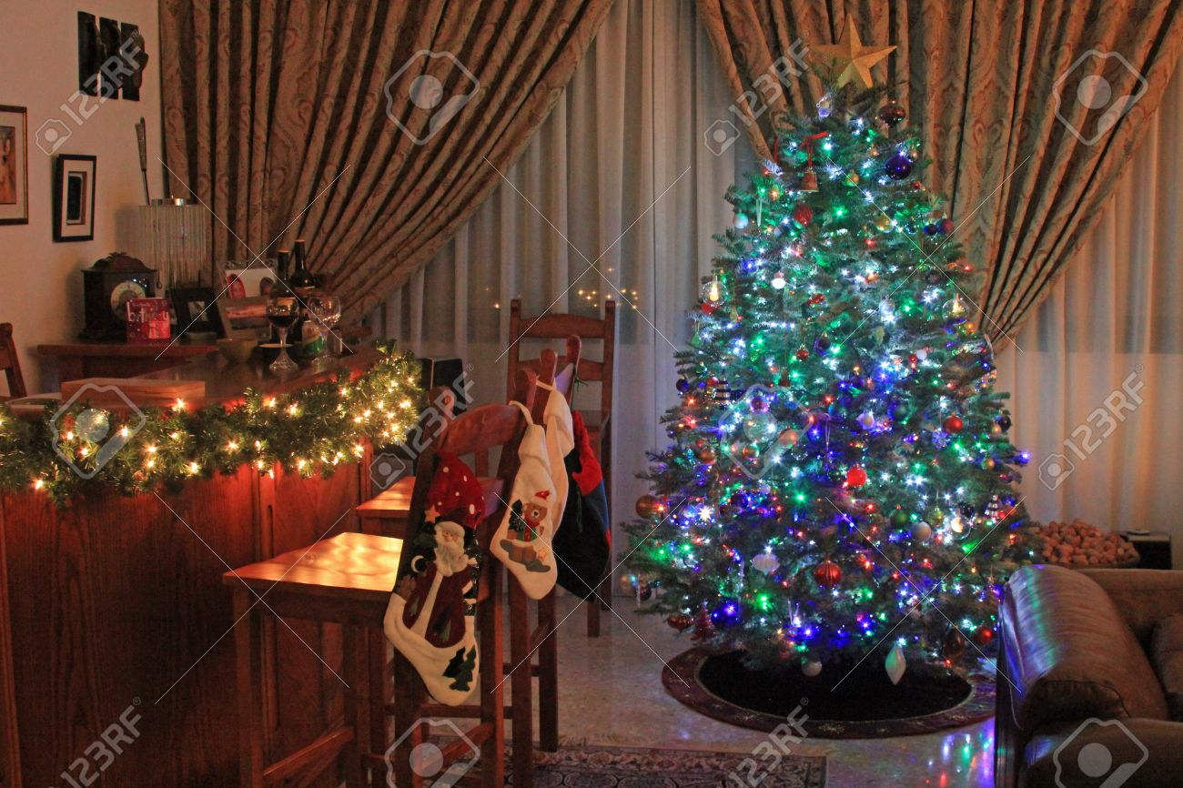 Festive Christmas Tree Decorated With Multicolored Lights And  - Multi Color Christmas Tree Decorations