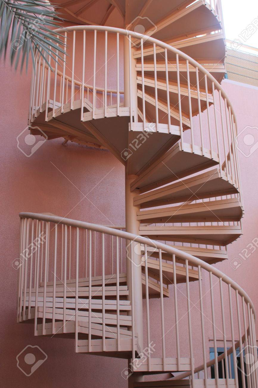 Outside Spiral Staircase Painted The Same Color As The Wall Creating A Clean  Look And Symbolizing